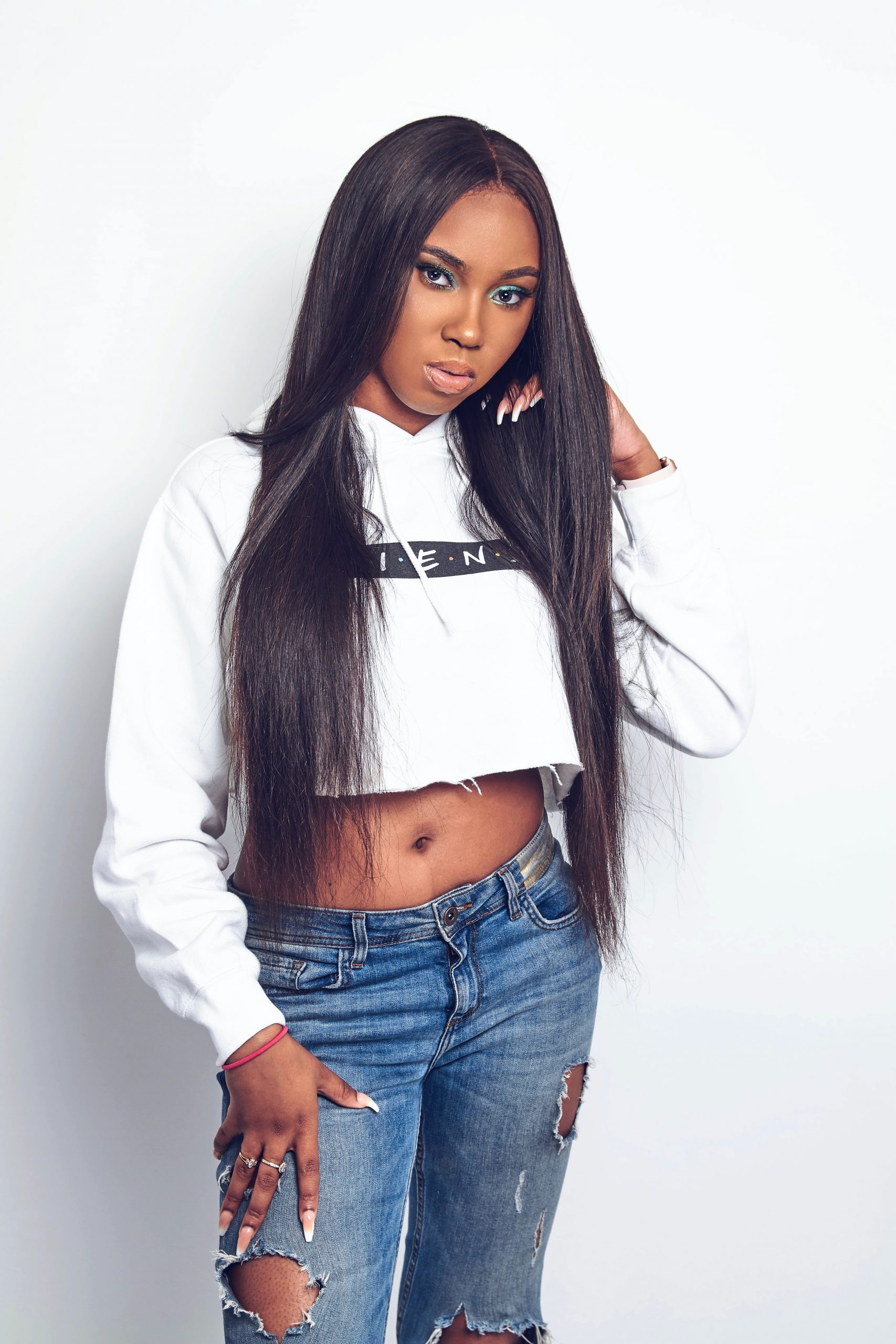 woman-wearing-white-crop-top-with-straight-virgin-hair-extensions