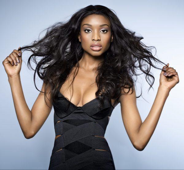 African-woman-with-sexy-black-shirt-holding-virgin-body-wave-extensions