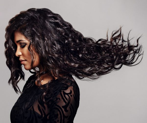 Woman-With-Flowing-Loose-Curls-Human-Hair-Extensions