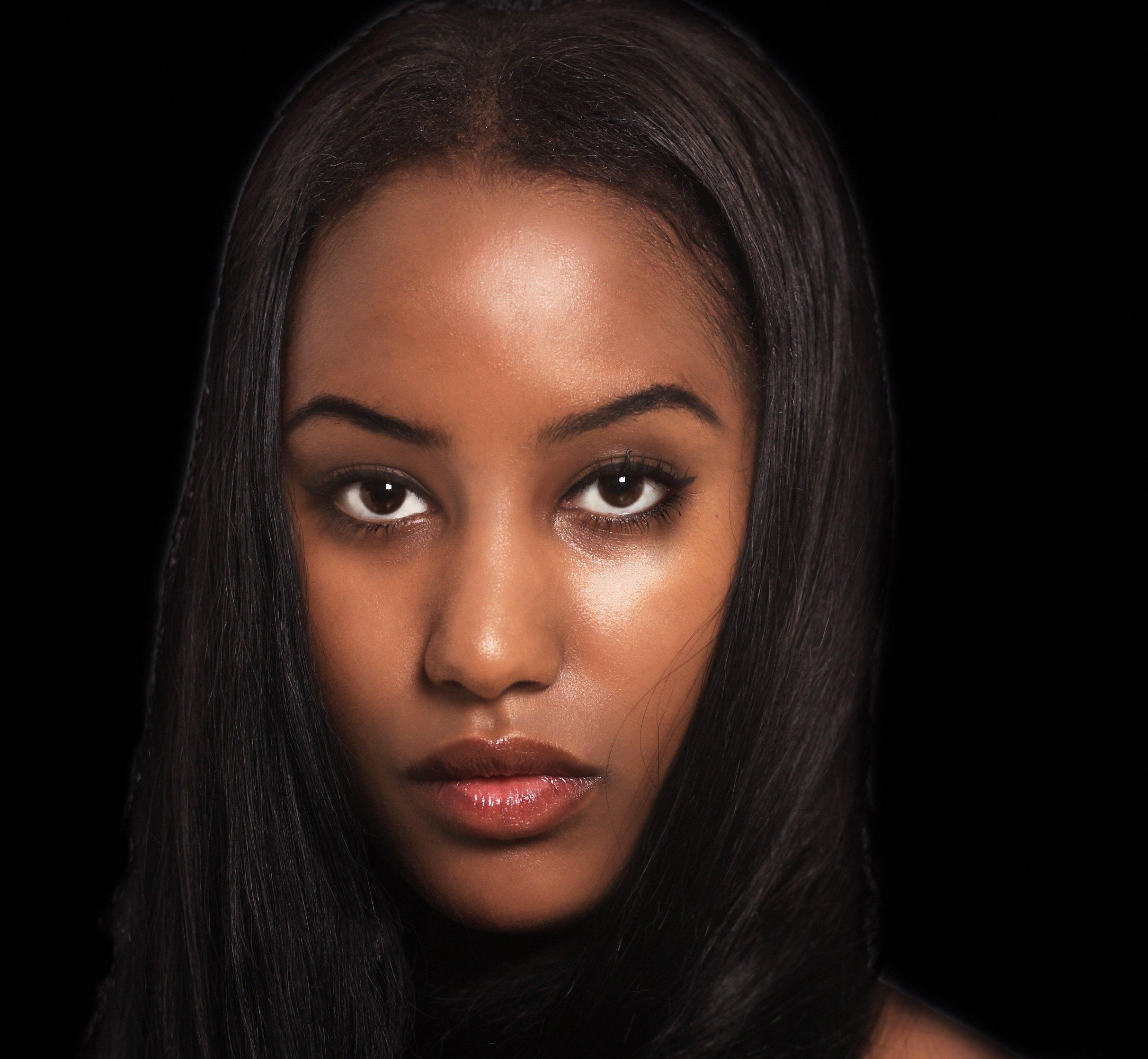 Woman expression, face portrait dark background