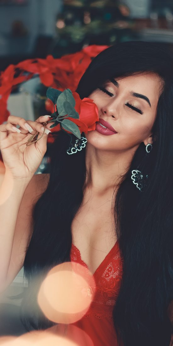 woman-in-red-floral-sheer-lace-v-neck-top-holding-red-flower-with-virgin-natural-straight-hair-extensions