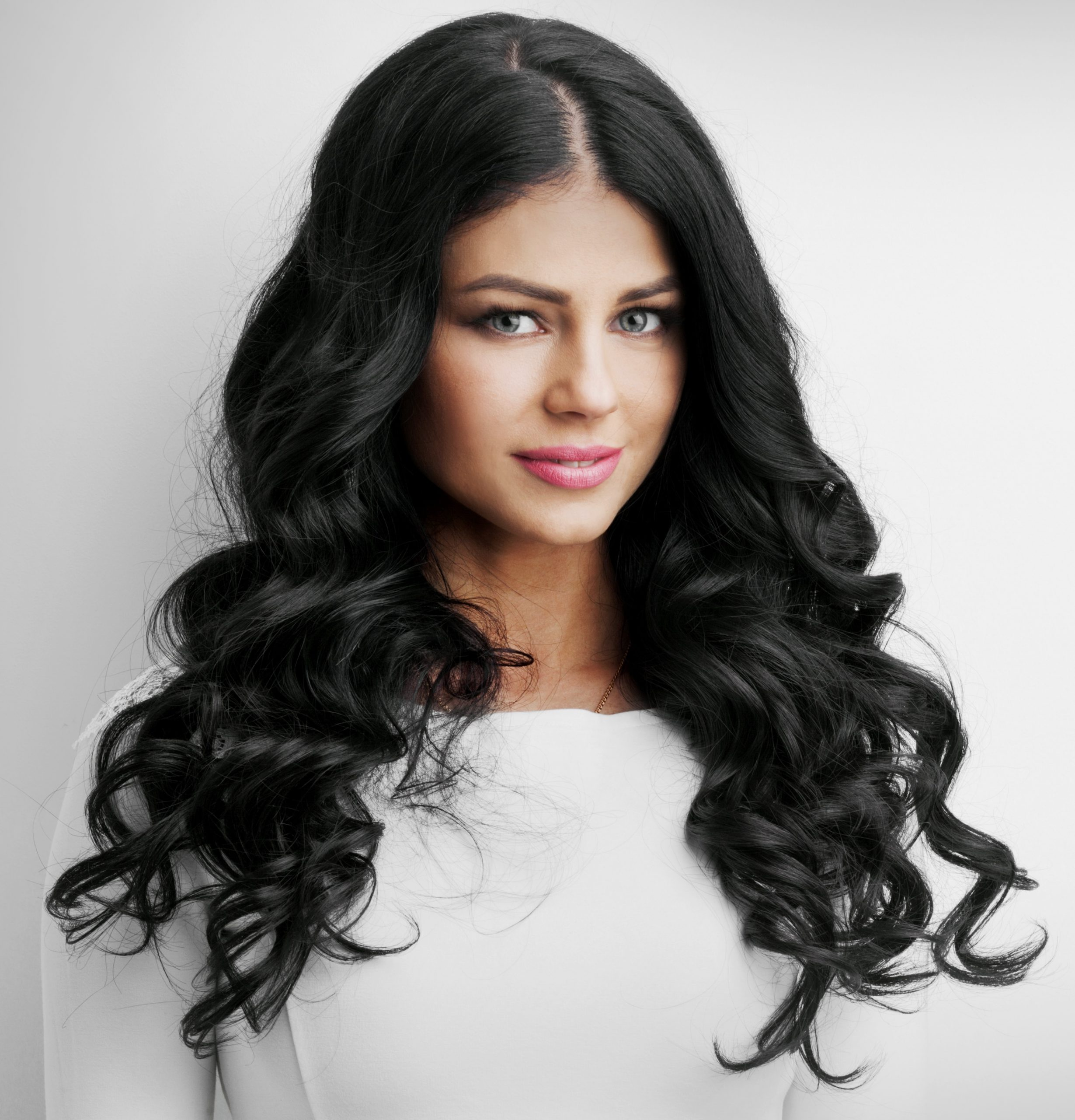 woman-wearing-white-with-black-virgin-deep-wave-extensions